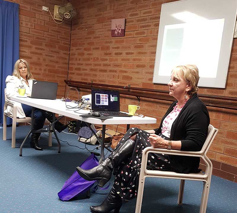 Image description: Bronia presenting to a peer network meeting